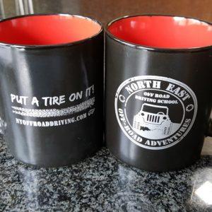 NORA4x4_Coffee_Mug_Put_Tire.sm